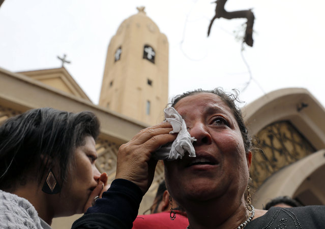 A relative of one of the victims reacts after a church explosion killed at least 21 in Tanta, Egypt, April 9, 2017. (Photo by Mohamed Abd El Ghany/Reuters)