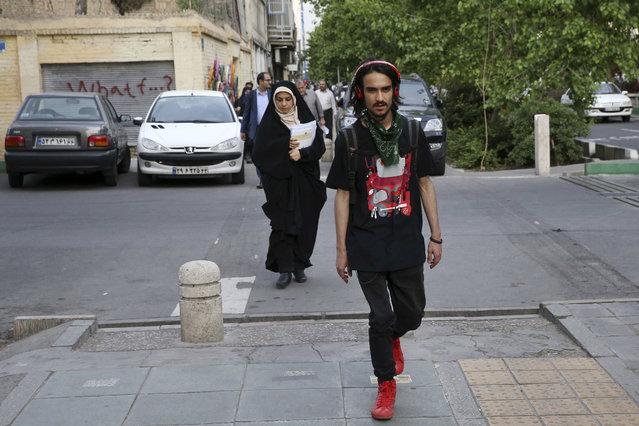 Iranians walk in downtown Tehran, Iran, Tuesday, April 26, 2016. (Photo by Vahid Salemi/AP Photo)