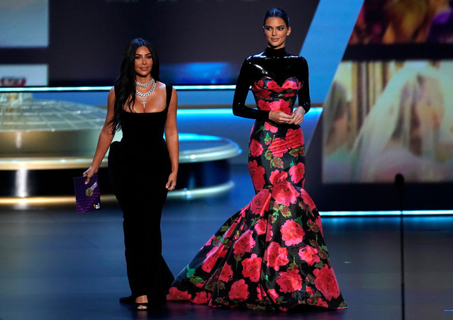 (L-R) Kim Kardashian West and Kendall Jenner speak onstage during the 71st Emmy Awards at Microsoft Theater on September 22, 2019 in Los Angeles, California. (Photo by Mike Blake/Reuters)