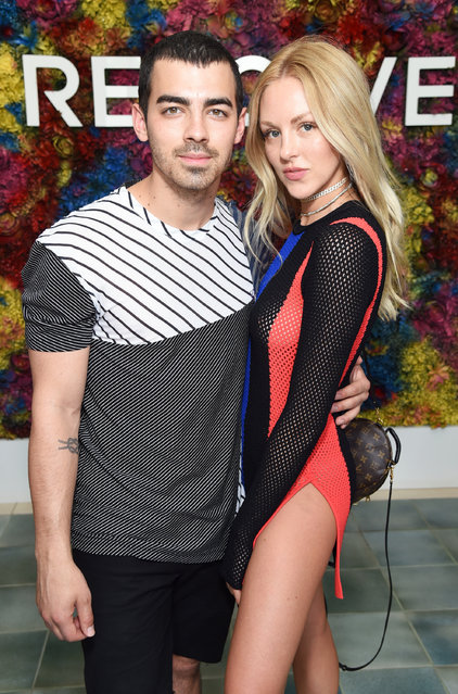Singer Joe Jonas (L) of DNCE and model Shea Marie attend the REVOLVE Desert House during Coachella with Moet & Chandon on April 16, 2017 in Palm Springs, California. (Photo by Michael Kovac/Getty Images for Moet)