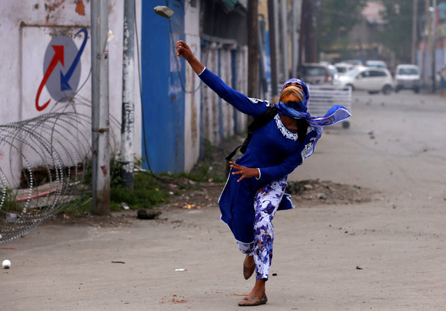 A student throws a rock towards Indian police during a protest in Srinagar, Indian controlled Kashmir, Monday, April 24, 2017. (Photo by Danish Ismail/Reuters)