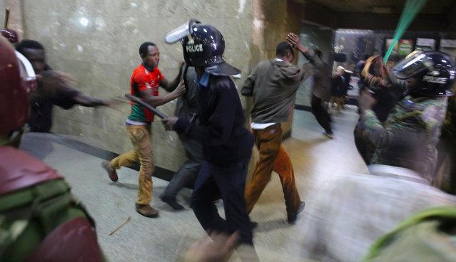 Kenyan policemen beat protesters during clashes in Nairobi, Kenya May 16, 2016. (Photo by Goran Tomasevic/Reuters)