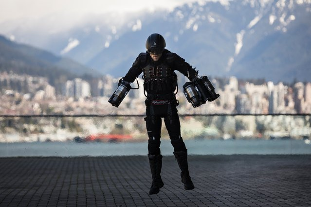 British inventor Richard Browning liftS off at a TED conference in Vancouver, Canada, on April 27, 2017. Using thrusters attached to his arms and back, Browning flew in a circle and hovered a short distance from the ground, captivating attendees of a prestigious TED Conference with the demonstration. The personal flight suit is capable of propelling wearers much higher and faster, according to its creators. (Photo by Bret Hartman/TED)