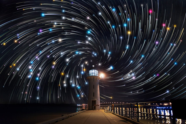 Star trails photographed by Justin Ng seen behind a lighthouse in Tuas, Singapore. These astonishing images of night sky are captured by Singapore based photographer Justin Ng. The pictures were taken between November 2013 to January 2014. It show's star trail caused by the earth's rotation and also can be achieved by zooming the DSLR lens inward or outward in small steps using a dedicated motorized zooming device. (Photo by  Justin Ng/Barcroft Media)