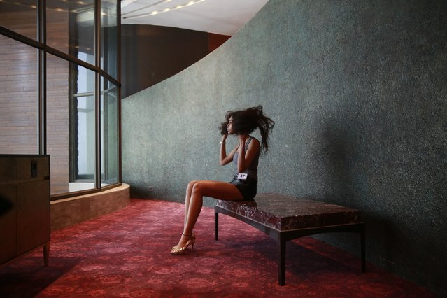 A model adjust her hair as she waits for the audition of the upcoming Lakme Fashion Week in Mumbai, India, Wednesday, July 15, 2015. The event is scheduled to begin August 26 in Mumbai. (Photo by Rafiq Maqbool/AP Photo)