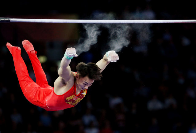 China's Sun Wei performs on the horizontal bar during the men's team final at the FIG Artistic Gymnastics World Championships at the Hanns-Martin-Schleyer-Halle in Stuttgart, Germany on October 9, 2019. (Photo by Wolfgang Rattay/Reuters)