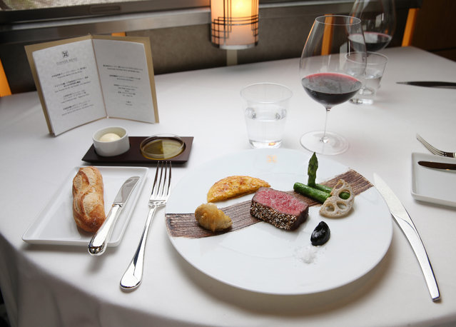 "A dinner offered at the Dining of the JR East's ""Train Suite Shiki-Shima"" is seen during the press preview on April 26, 2017 in Tokyo, Japan. The luxury sleeper train will begin operation on May 1. The most expensive room on the train is the Shiki-Shima suite that can accommodate two in a space of about 20 square meters, with each passenger coughing up 950,000 Japanese yen (8,600 U.S. dollars) for a three-night, four-day trip. (Photo by The Asahi Shimbun via Getty Images)"