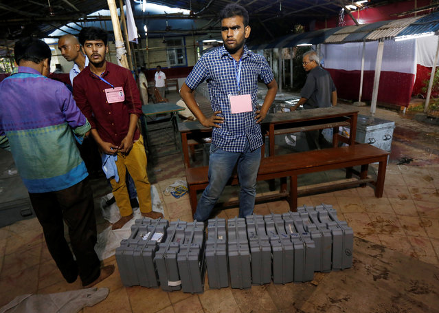 Election officials stand next to electronic voting machines (EVM) before being distributed to them in the West Bengal Assembly elections, at a counting center in Kolkata, India May 19, 2016. (Photo by Rupak De Chowdhuri/Reuters)