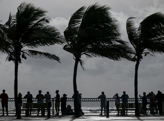 Beach goers in Sexton Plaza watch the waves crash onto Vero Beach as Hurricane Dorian inches closer to Florida's Treasure Coast on Monday, Sept. 2, 2019. (Photo by Matias J. Ocner/Miami Herald/Tribune News Service via Getty Images)