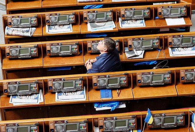 A lawmaker looks on before a session of Ukrainian parliament in Kiev, Ukraine on August 29, 2019. (Photo by Gleb Garanich/Reuters)