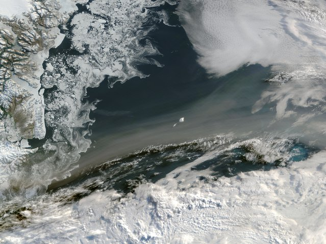 The Moderate Resolution Imaging Spectroradiometer (MODIS) aboard NASA's Aqua satellite captured this true-color image of a river of smoke passing over the Greenland Sea. The smoke most likely arose from fires in Canada and Alaska. (Photo by Jeff Schmaltz/NASA/LANCE/EOSDIS MODIS Rapid Response Team, NASA GSFC)