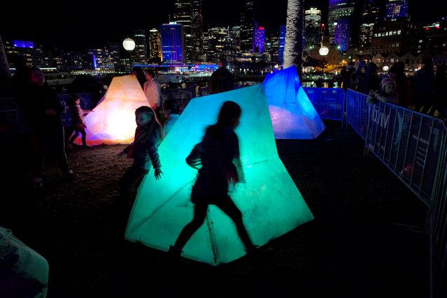 Children run around multicoloured blocks on the second night of the annual Vivid Sydney light festival in Sydney, Australia, May 28, 2016. (Photo by Jason Reed/Reuters)