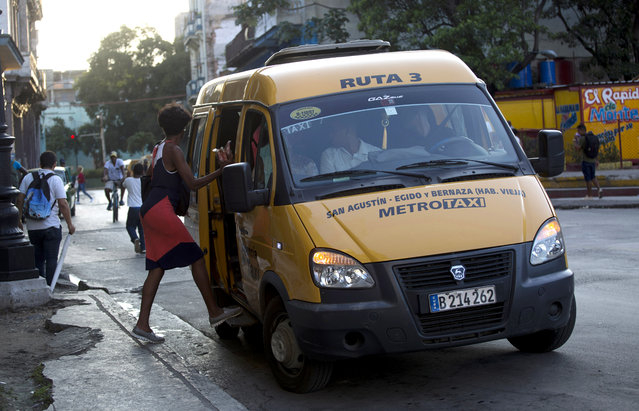 A Russian-made Gacela minibus stops for a passenger in Havana, Cuba, Wednesday, October 23, 2019. Over the last year Russia has sent Cuba 1,000 minibuses, 50 locomotives, tens of thousands of tourists and a promise to upgrade the island's power grid with a multi-million dollar improvement plan. (Photo by Ismael Francisco/AP Photo)