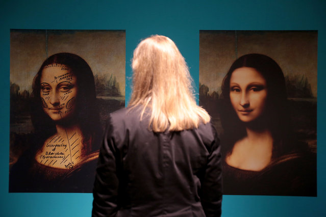 "A file picture dated 03 June 2016 shows a woman standing in front of two images of Mona Lisa with plastic surgery suggestions in Bonn, Germany. The pieces are a part of an exhibition titled ""Eva's Beauty Case"" which will be shown at the LVR Industrial Museum in Bonn from 09 June 2016 to 22 January 2017. (Photo by Oliver Berg/EPA)"