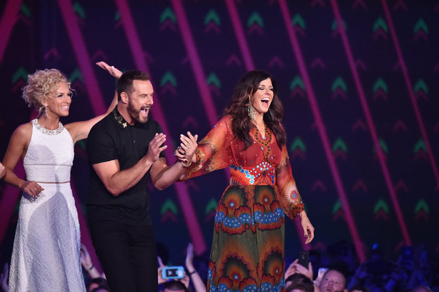 Kimberly Schlapman, Phillip Sweet and Karen Fairchild from musical group Little Big Town accept an award onstage during the 2016 CMT Music awards at the Bridgestone Arena on June 8, 2016 in Nashville, Tennessee. (Photo by Mike Coppola/Getty Images for CMT)