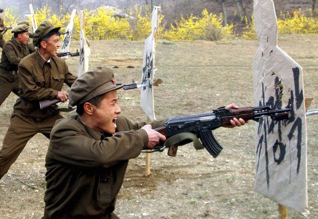 Members of the Worker-Peasant Red Guards of North Korea attend a military training in this picture released by the North's KCNA news agency in Pyongyang. KCNA said the picture was taken on April 23, 2012. A target (R) reads, (South Korean President) Lee Myung-bak