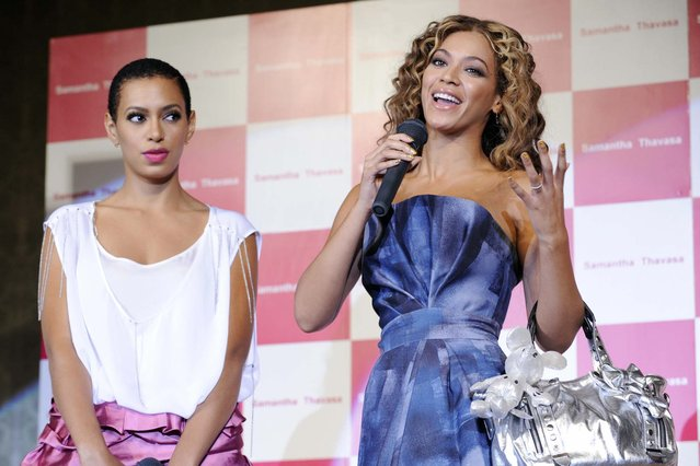 "US pop star Beyonce Knowles (R) and her younger sister Solange display bags and accessories featuring Disney characters by Japanese fashion brand ""Samantha Thavasa"" at the launch of the Disneyland Hotel in Urayasu, in Chiba prefecture, suburban Tokyo on August 10, 2009. (Photo by Yoshikazu Tsuno/AFP Photo)"