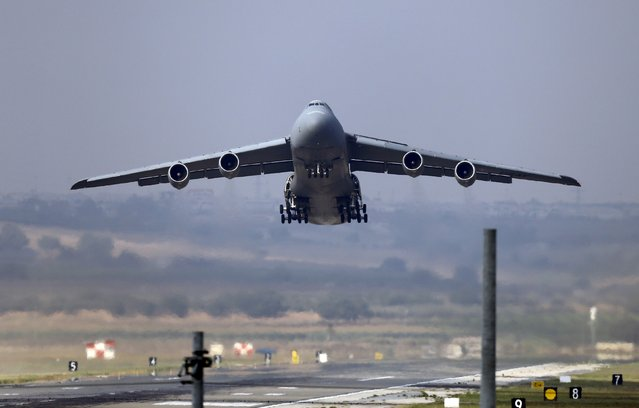 A U.S. Air Force C-5 Galaxy Outsize Cargo Transport Aircraft takes off from Incirlik air base in Adana, Turkey, August 10, 2015. (Photo by Murad Sezer/Reuters)
