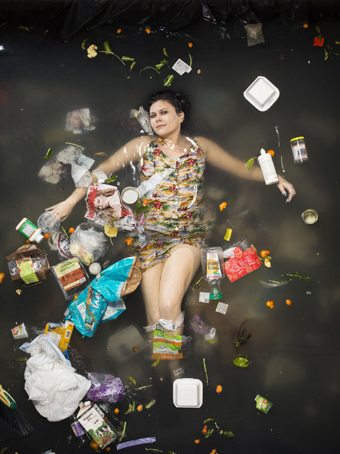 Gaby surrounded by seven days of her own rubbish in Pasadena, California. (Photo by Gregg Segal/Barcroft Media)