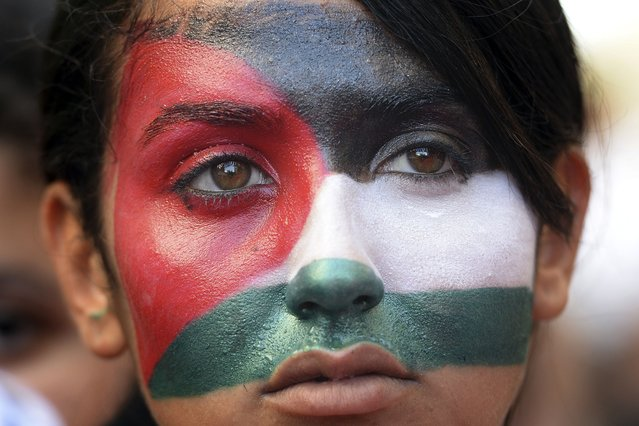 A woman whose face is painted with the colors of the Palestinian flag takes part in a demonstration against Israel's military campaign in Gaza and show their support to the Palestinian people, on July 26, 2014 in Marseille, southern France. US Secretary of State John Kerry and other top diplomats from Europe and the Middle East began talks in Paris on July 26 to press efforts for a long-term ceasefire between Israel and Hamas. (Photo by Boris Horvat/AFP Photo)
