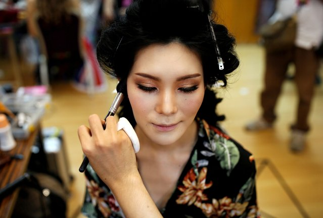 Rio Takahashi of Japan gets ready for the final show of the Miss International Queen 2020 transgender beauty pageant in Pattaya, Thailand on March 7, 2020. (Photo by Soe Zeya Tun/Reuters)