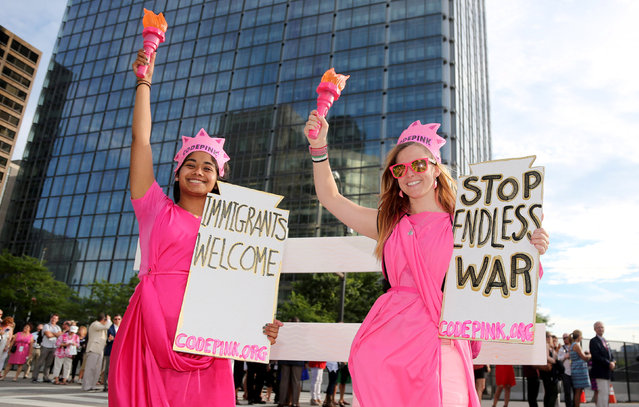 Aniqua Raiham (L) and Alli McCraken express their opinion outside the gates of a Rock the Night kick off party on the sidelines of the Republican National Convention in Cleveland, Ohio, U.S., July 17, 2016. (Photo by Aaron Josefczyk/Reuters)