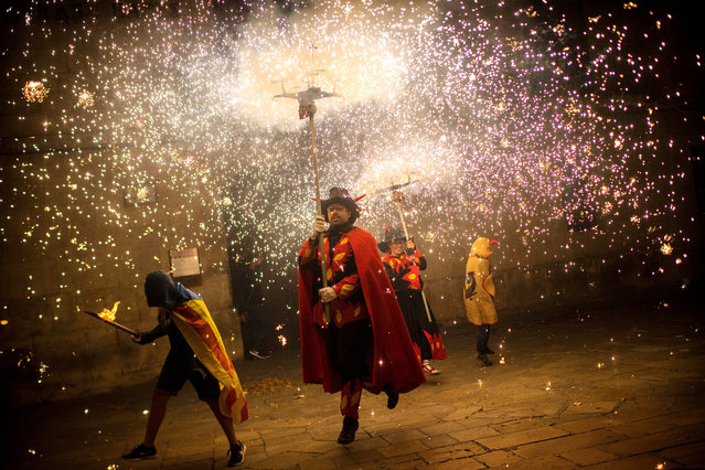 """""""Correfocs"""" perform during a Catalan pro-independence demonstration on September 10, 2017 in Vilafranca del Penedes, Spain. The Spanish Northeastern autonomous region celebrates its National Day on September 11 marked by the secession referendum of the next October 1 which was approved by the Catalan Parliament and banned by the Spanish Government. (Photo by David Ramos/Getty Images)"""