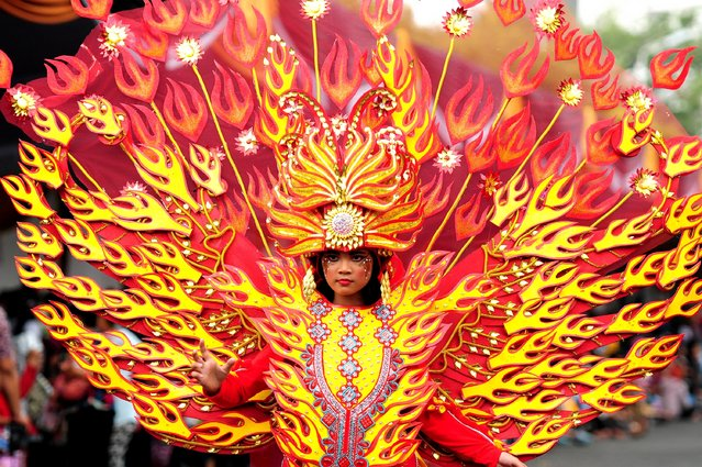 A model wears a Phoenix costume in the kids carnival during The 13th Jember Fashion Carnival 2014 on August 21, 2014 in Jember, Indonesia. (Photo by Robertus Pudyanto/Getty Images)