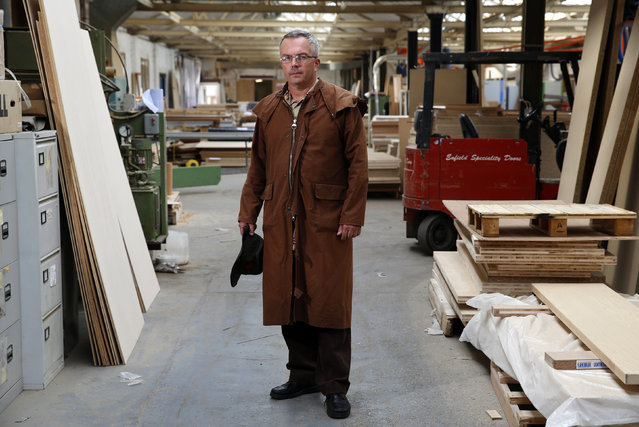 Factory landlord Lawrence Taylor poses in the factory he rents to Enfield Speciality Doors in Enfield, north London, August 12, 2014. (Photo by Luke MacGregor/Reuters)