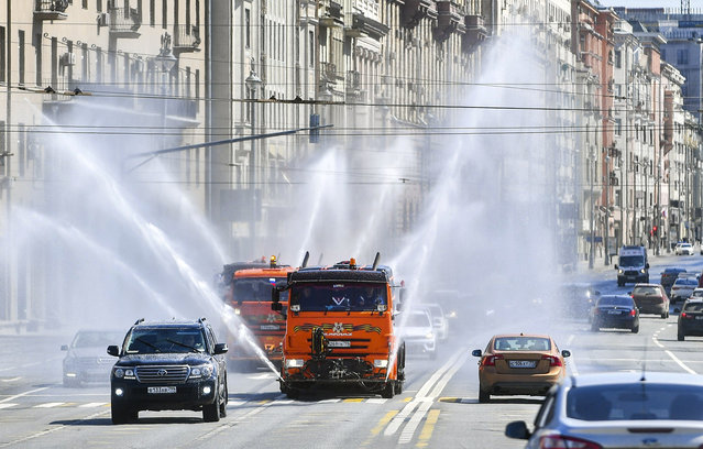 Vehicles spray disinfectant while sanitizing a road amid the outbreak of the coronavirus disease (COVID-19) in Moscow, Russia on May 1, 2020. (Photo by Sergei Kiselyov/Moscow News Agency/Handout via Reuters)