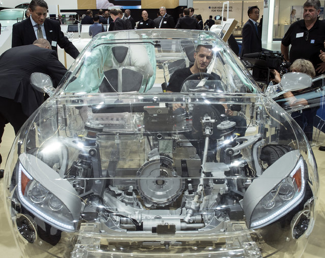 The transparent car of ZF company equipped with different security systems is presented on the second press day of the Frankfurt Auto Show IAA Frankfurt, Germany, Wednesday, September 16, 2015. The car show runs through Sept. 27. (Photo by Jens Meyer/AP Photo)