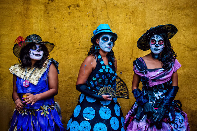 """""""Painted Ladies"""". Young women dress up and have their faces painted to celebrate the dead. Dia de los Muertos is an incredible celebration of life, and a beautiful way to remember those who have passed. Photo location: Oaxaca, Mexico. (Photo and caption by Daniel Kudish/National Geographic Photo Contest)"""