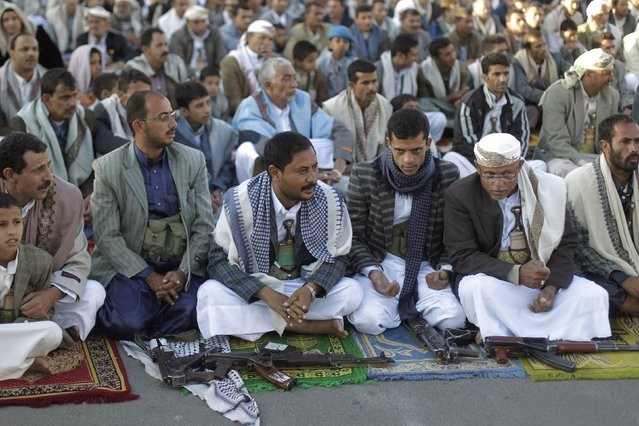 Supporters of the Shi'ite Muslim Houthi movement attend Eid al-Adha prayers, in Sanaa October 4, 2014. Eid al-Adha, due to start this year on October 4, is a holiday where Muslims across the world slaughter animals and feed the poor to seek God's forgiveness. (Photo by Khaled Abdullah/Reuters)