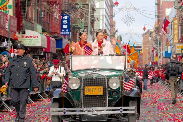 """""""Lunar New Year Parade"""". In New York City's Chinatown, the annual Lunar New Year Parade – with its pretty girls, colorful costumes, confetti, and casings from spent firecrackers visible on the streets – brings the first hopeful signs of Spring. Photo location: Mott Street, Chinatown, New York City. (Photo and caption by Staton Rabin/National Geographic Photo Contest)"""