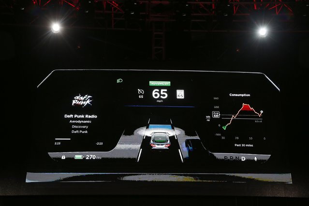 The dashboard of a new all-wheel-drive version of the Tesla Model S car is shown on a screen in Hawthorne, California October 9, 2014. Tesla Motors Inc on Thursday took its first step toward automated driving, unveiling features that will allow its electric sedan to park itself and sense dangerous situations. The company also said it will roll out an all-wheel drive option of the Model S sedan that can go from zero to 60 miles per hour in 3.2 seconds yet doesn't compromise the vehicle's efficiency. (Photo by Lucy Nicholson/Reuters)