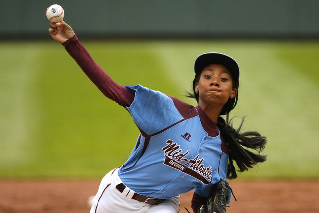 In this August 15, 2014, file photo, Pennsylvania's Mo'ne Davis delivers in the first inning against Tennessee during a baseball game at the Little League World Series tournament in South Williamsport, Pa. Davis is headed to the Baseball Hall of Fame. Davis, the first girl to win a game at the Little League Baseball World Series, will donate the jersey she wore during the game to the museum on Thursday. (Photo by Gene J. Puskar/AP Photo)