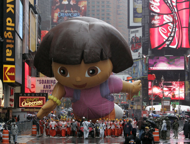 The Dora the Explorer balloon moves through Times Square during the Macy's Thanksgiving Day parade Thursday, November 23, 2006 in New York. (Photo by Frank Franklin II/AP Photo)