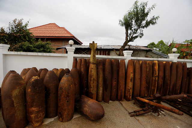 A courtyard is used as a deposit of bombs dropped by the U.S. Air Force planes during the Vietnam War in Xieng Khouang, Laos September 1, 2016. (Photo by Jorge Silva/Reuters)