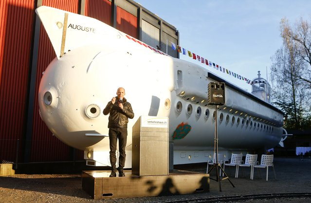 "Bertrand Piccard speaks as he stands in front of the submarine Mesoscaphe PX-8 ""Auguste Piccard"" constructed by his father Jacques Piccard at the Verkehrshaus der Schweiz traffic museum in Luzern October 30, 2014. The PX-8 was the world's first tourist submarine and during the Swiss national fair EXPO 64 in 1964 and 1965 it took 30,000 visitors in 1,100 dives in Lake Geneva to a depth of approximately 100 metres (328 feet). (Photo by Arnd Wiegmann/Reuters)"