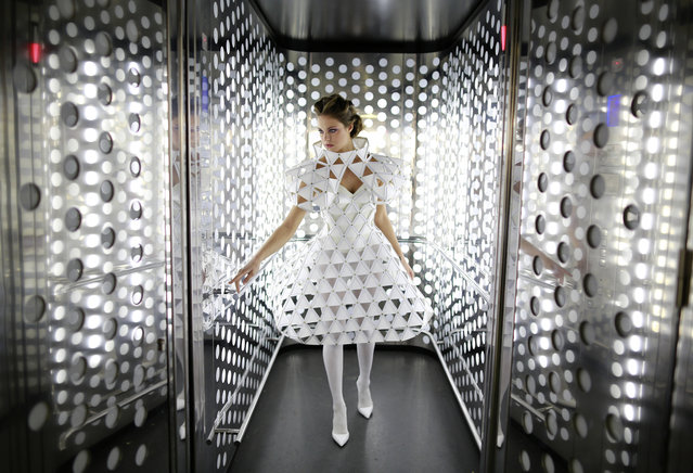 Spanish model, Raquel Bonilla, 22, poses inside an elevator as she wears a creation by Myriam Hurtado during an urban photo shooting part of the Andalucia de Moda (Andalusia Fashion) in Seville, southern Spain, November 4, 2014. (Photo by Marcelo del Pozo/Reuters)