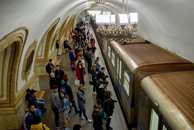 The metro, which was named after Vladimir Ilyich Lenin, was designed to showcase the biggest communist regime to the world. According to the Moscow transport department, the rail system has more than 8 million visitors a day – making it the busiest metro system in Europe. It also holds the world record for timekeeping. (Photo by Didier Bizet/The Washington Post)