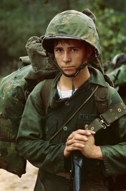 """Da Nang, Vietnam. A young Marine  private waits on the beach during the Marine landing, August 3, 1965"". (Photo by an unknown photographer)"