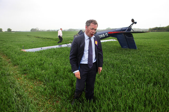 """""""After the crash"""". UKIP Candidate Nigel Farage narrowly escapes death after his light aircraft crashed to the ground in Hinton Airfield, Bucks, 2010. (Photo by Neil Hall)"""
