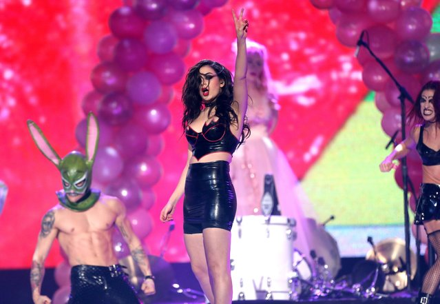Charli XCX performs on stage at the 42nd annual American Music Awards at Nokia Theatre L.A. Live on Sunday, November 23, 2014, in Los Angeles. (Photo by Matt Sayles/Invision/AP Photo)
