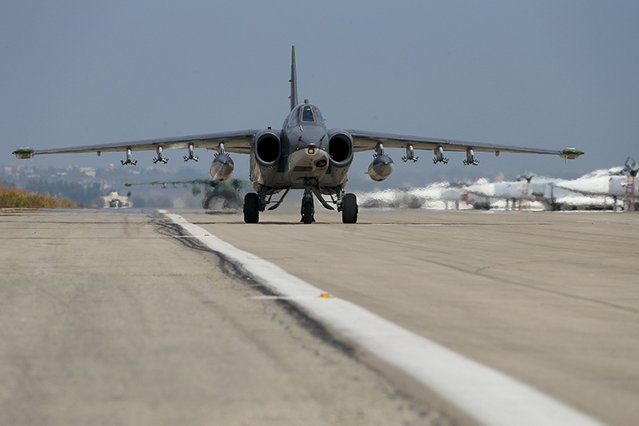 Sukhoi Su-25 fighter jets taxi on the tarmac at the Hmeymim air base near Latakia, Syria, in this handout photograph released by Russia's Defence Ministry October 22, 2015. (Photo by Reuters/Ministry of Defence of the Russian Federation)