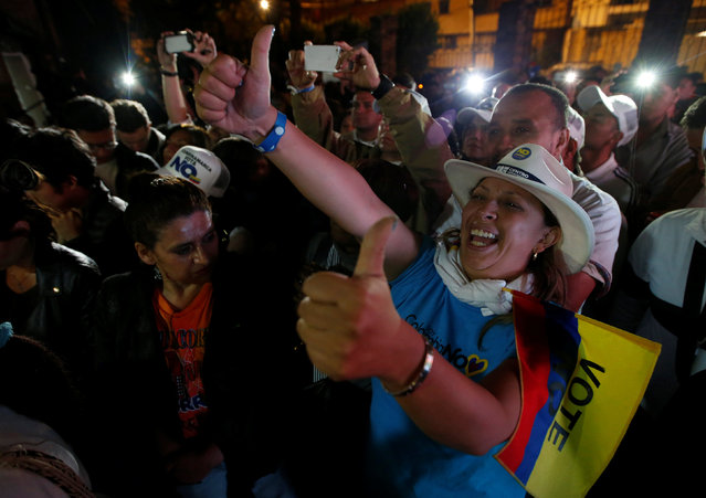 "Supporters of ""No"" vote celebrate after the nation voted ""No"" in a referendum on a peace deal between the government and Revolutionary Armed Forces of Colombia (FARC) rebels, in Bogota, Colombia, October 2, 2016. (Photo by John Vizcaino/Reuters)"