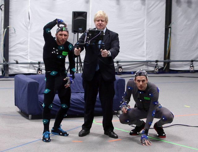 Mayor of London Boris Johnson with actor Matt Cross (left) and Dawson James as he visits The Imaginarium at Ealing Studios in West London, where he took part in a Performance Capture session, on April 4, 2013. (Photo by Steve Parsons/PA Wire)
