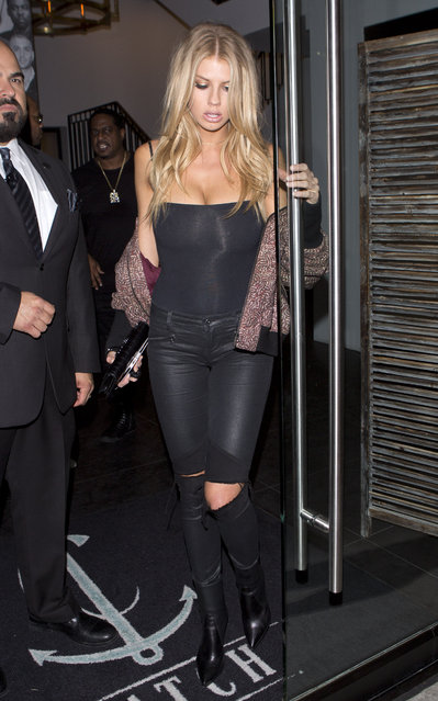 "Charlotte McKinney goes Bra-less in a black singlet top with an off the shoulder jacket as she was seen leaving ""Catch"" in West Hollywood, CA October 6, 2016. (Photo by SPW/Splash News)"