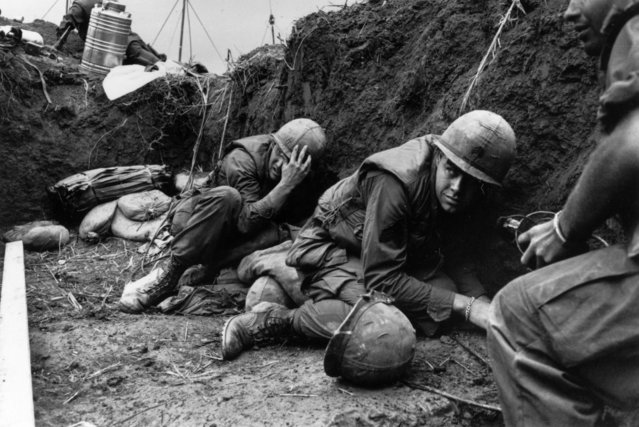 US troops take cover from the Vietcong in a trench on Hill Timothy, during the Vietnam War, 1968. (Photo by Terry Fincher/Daily Express/Hulton Archive/Getty Images)