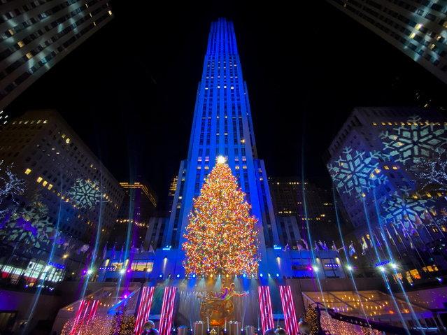 The Christmas tree is lit at Rockefeller Center in the Manhattan borough of New York City, New York, U.S., December 2, 2020. (Photo by Eduardo Munoz/Reuters)
